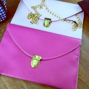 2 faux leather clutch's
